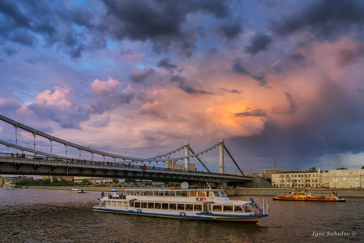 Moscow ships against the backdrop of the Crimean bridge and thunderclouds