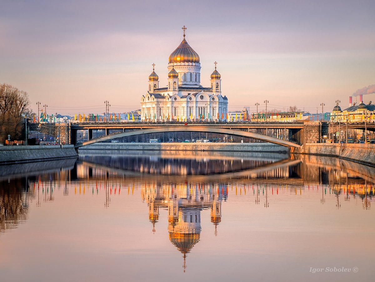 Reflection of the Cathedral of Christ the Savior in the morning in the Moscow River