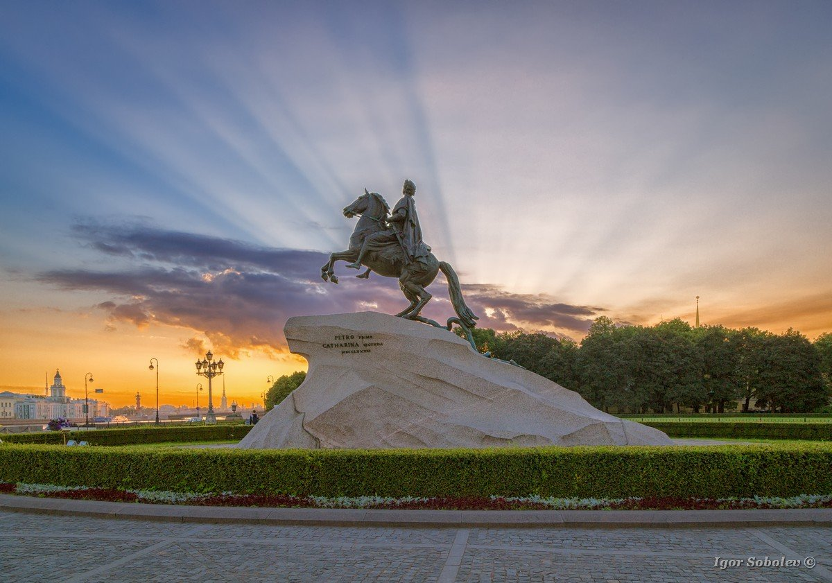 """The Bronze Horseman - statue of Peter the Great in Saint Petersburg, Russia. Text on the stone: """"Catherine the Second to Peter the First, 1782"""". Constitutional Court. St. Petersburg."""