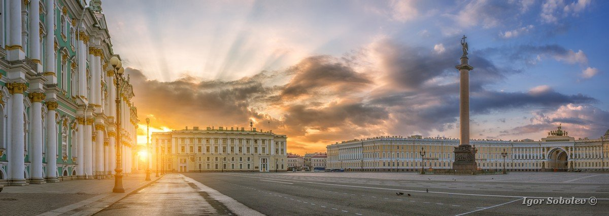 Panorama of the Palace Square with the Winter Palace, the Alexandrian Pillar against the background of the rays of the Rising Sun