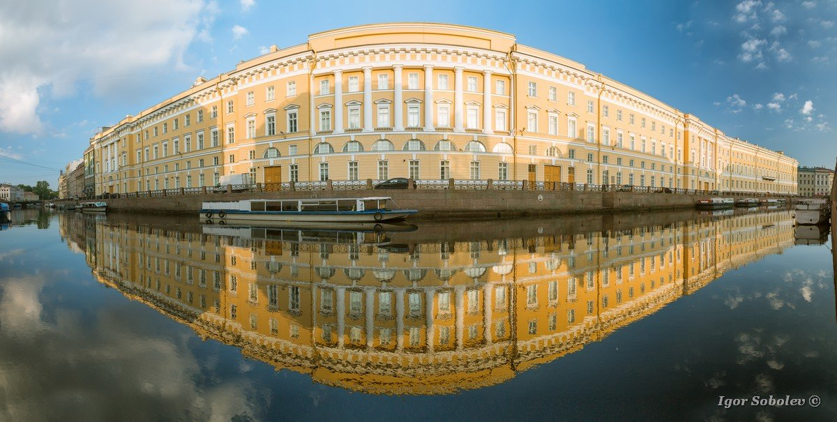 Panorama of the reflection of the old house in the river Moika i