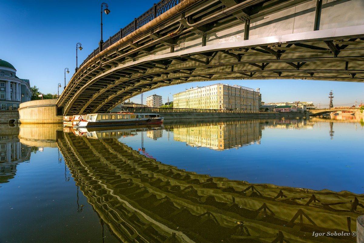 Reflection Luzhkov bridge in Moscow