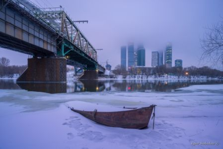 Boat on the winter against the of Moscow City