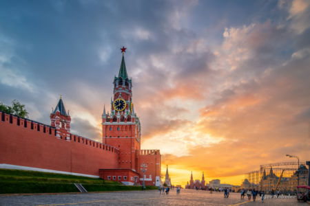 Moscow, Russia - May 15, 2018, Spasskaya Tower of the Moscow Kremlin against the setting sun