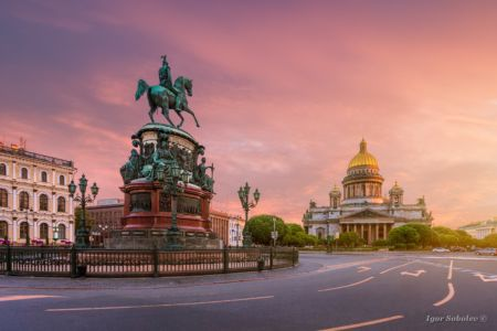 St. Isaac's Square in St. Petersburg with a red dawn sky