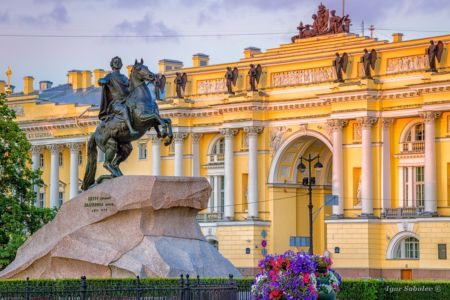 "The Bronze Horseman - statue of Peter the Great in Saint Petersburg, Russia. Text on the stone: ""Catherine the Second to Peter the First, 1782"". Constitutional Court. St. Petersburg."