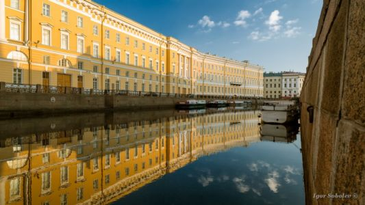 Reflection of an old house in the river Moika in St. Petersburg