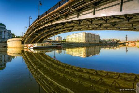 Reflection Luzhkov bridge in Moscow